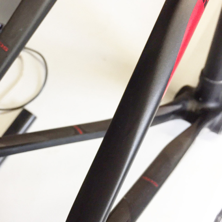 Scott CR1 Repair. Our Ruby level repair saves on the cost of reproducing what can be expensive frame graphics. We repaired the carbon fibre and finished in satin black with a hint of anthracite to blend into the existing
