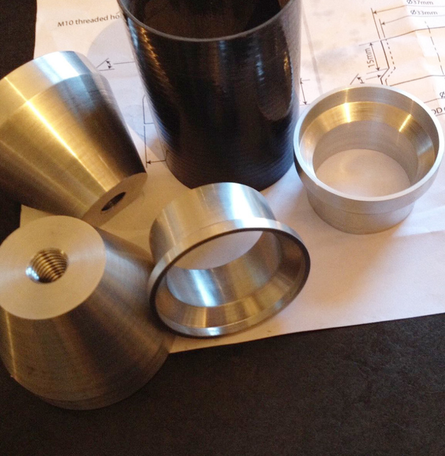 Custom machined components, bearing cups.